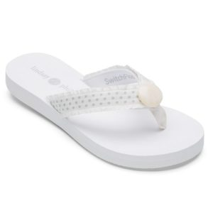 white sandals with polka dot strap and white button in center