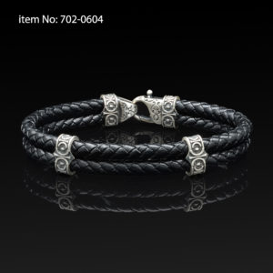 Sterling silver bracelet with Axion motif washers and braided black leather
