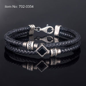 Hand crafted sterling silver bracelet with black onyx motif (12 mm). Genuine braided leather