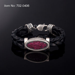 Sterling silver bracelet with red zirgon stones set in motif 12 mm. Genuine braided leather