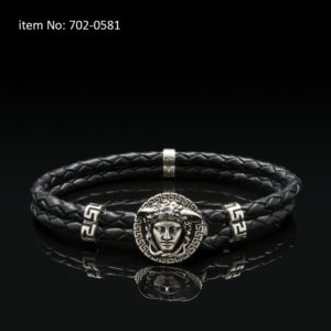 Sterling silver bracelet with Medusa motif and meanders. Genuine braided leather