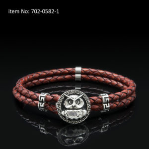 Sterling silver bracelet with owl motif and meanders. Genuine braided red leather