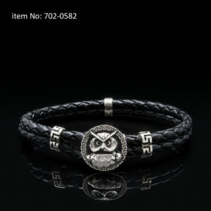 Sterling silver bracelet with owl motif and meanders. Genuine braided leather