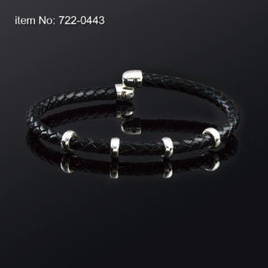 Sterling silver bracelet with washers and genuine braided black leather