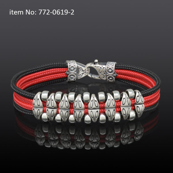 Sterling silver bracelet with motif washers and black-red quadruple cord