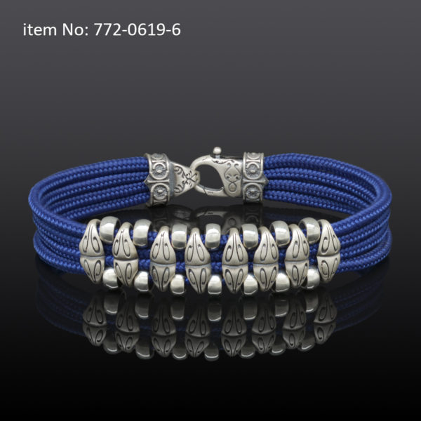 Sterling silver bracelet with motif washers and blue quadruple cord