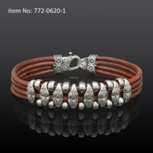 Sterling silver bracelet with motif washers and braided brown quadruple leather