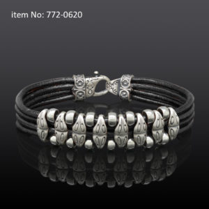 Sterling silver bracelet with motif washers and braided black quadruple leather