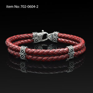 Sterling silver bracelet with Axion motif washers and braided red leather