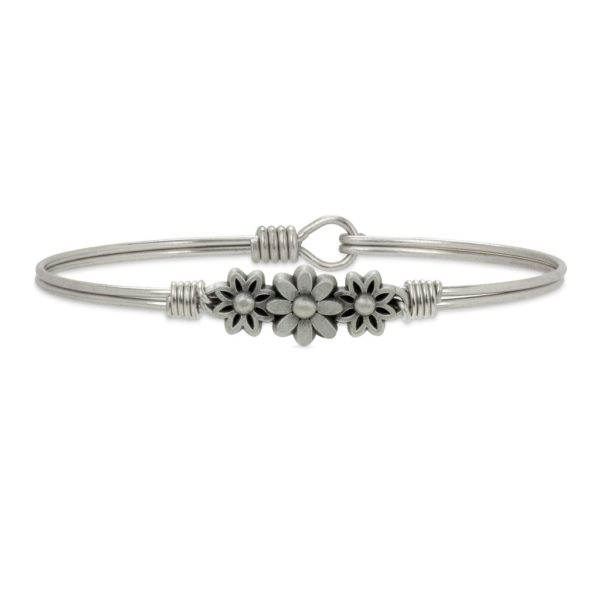 Daisy Bangle Bracelet Petal to the metal. A cheerful cluster of daisies brightens any day with perennial optimism. handcrafted in the USA by luca + danni