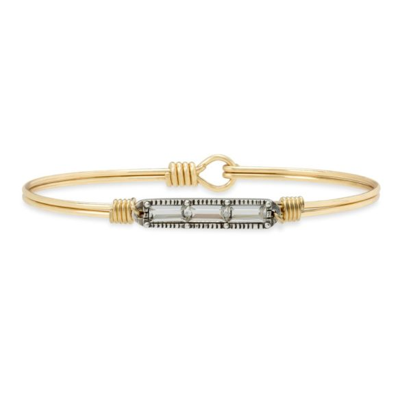 Mini Hudson Bangle Bracelet in Crystal It's the little things, don't you think? We scaled-down our bestselling Hudson design with a trio of extra-petite Swarovski® crystals, for a subtle dash of sparkle that's so right for stacking. handcrafted in the USA by luca + danni