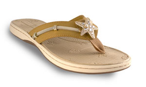 The Becca Tan is a molded EVA boat sandal with soft ribbon thong and a gold and crystals starfish signature snap.