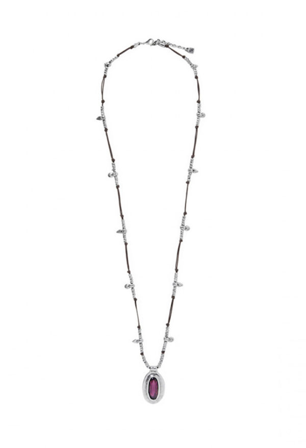 A long necklace made with a brown leather base and small silver plated beads. The central piece of the jewel is an original medallion with a Swarovski Elements crystal in amethyst color.