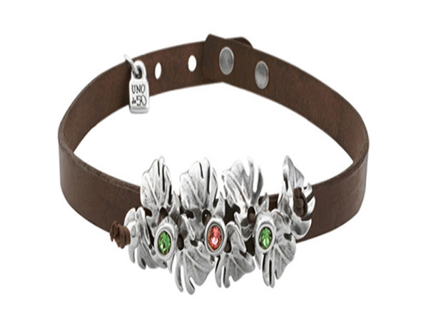 leather choker with banana leaves and orange and green stones in center by uno de 50