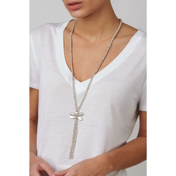 """Long boho chic style necklace composed of multiple silver-plated pieces, with a dragonfly, protagonist of the collection """"Sweetness"""", in its central part, its wings include grey SWAROVSKI® crystals. A piece that will give a fun and fresh touch to all your looks this season. A jewel made in Spain by UNOde50, 100% by hand."""