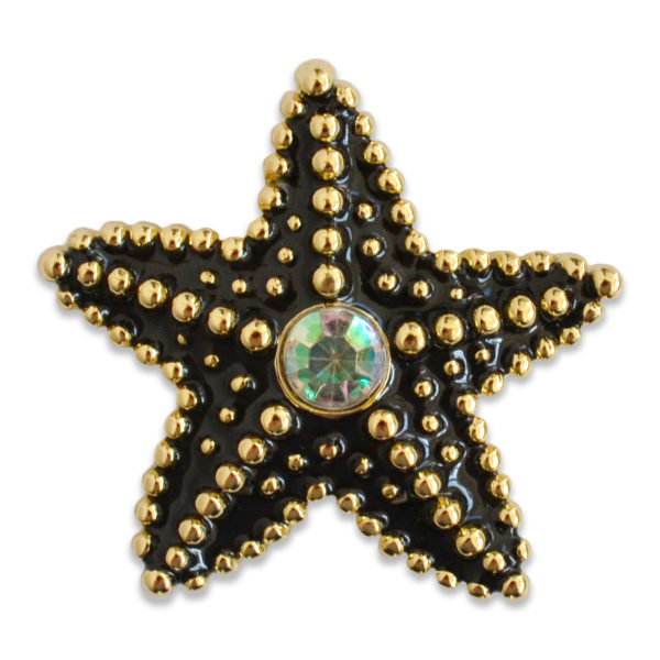 The Delilah snap is a black enamel starfish snap with crystal center stone on a gold base.