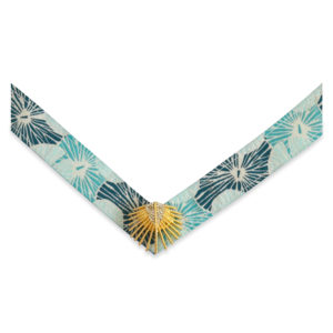 The Georgia strap is a turquoise, teal, and white fabric floral strap with a gold palm leaf ornament.