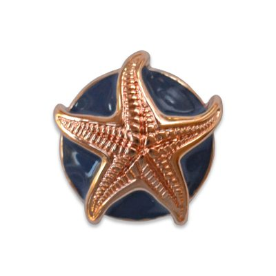 The Juliet snap is a navy enamel mini snap with rose gold starfish.