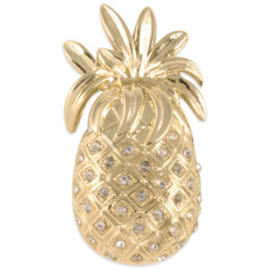 The Kinsey Snap is a shiny gold pineapple with crystal stones. lindsay phillips switch flops