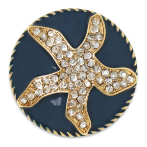 The Mia snap is a navy enamel domed snap adorned with a starfish shape made out of crystals.