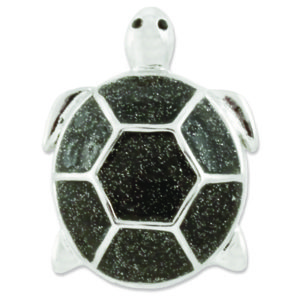 The Nelly Snap is a silver turtle with black glitter.