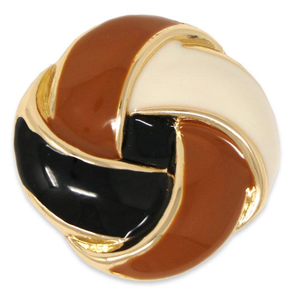 The Nova snap is a tan, black, and ivory enamel knot ornament.