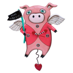 pink pig with wings holding flag that says when pigs fly and heart pendulum