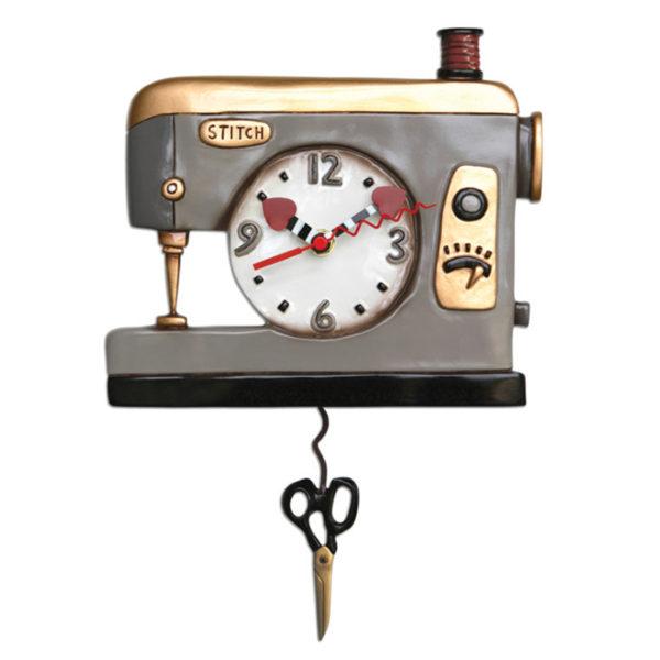 Grey Vintage sewing machine with scissors pendulum