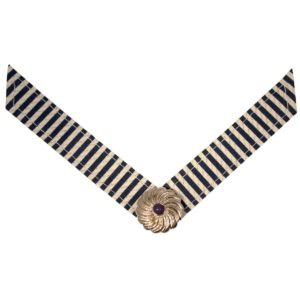 The Abby Strap is a navy and white stripe fabric with navy and gold ornament. lindsay phillips switch flops