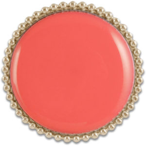 The Amelia snap is a round coral domed snap with a gold trimmed base. Perfect for monogramming.