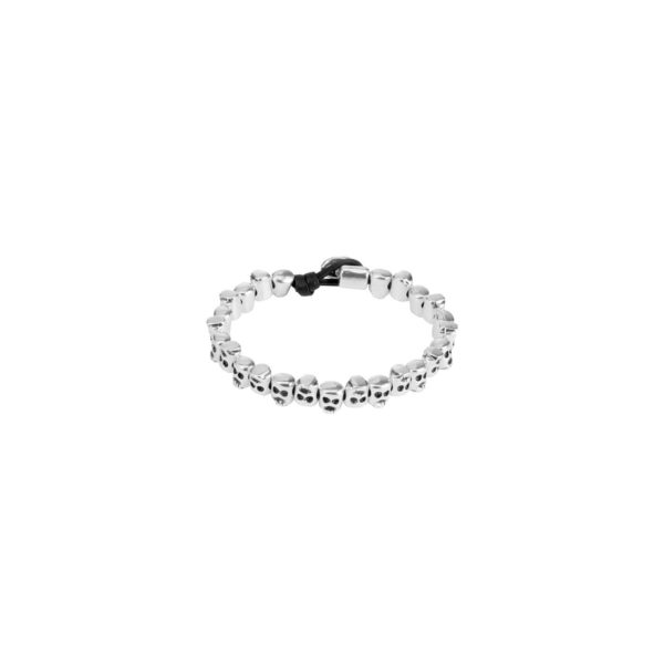 Leather bracelet consisting of various skull-shaped beads facing in opposite directions in silver-plated metal.