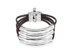 Bracelet with some leather lace turns in a dark brown with a curved silver plated tubular metal piece in each of them hancrafted uno de 50 spain