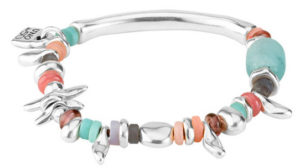 Elastic bracelet, boho chic style, composed of multiple silver-plated pieces and craft crystals in pastel tones. Includes small pieces dragonfly shaped and a tubular one in the middle. It also includes a charm with the characteristic padlock designed by UNOde50. A jewel made in Spain and 100% by hand. A jewel to wear at day.