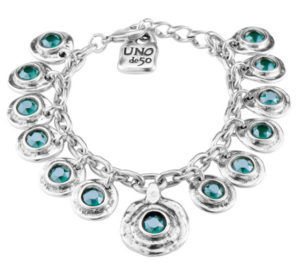 Silver plated bracelet inspired by Aztec Culture, composed of silver charms with circular shape and a SWAROVSKI® central crystal in Royal Green matte colour inside. All silver plated. A jewel plenty of mistery and colour that remind us the Aztec architecture and temples. A piece to an original and unique woman made in Spain by UNOde50 and 100% handmade.