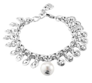 Silver plated bracelet, composed of several silver charms with a circular shape and a central white pearl in the center. All silver plated and inspired by Aztec Civilization's treasures. An original and powerful piece to a unique woman. Made in Spain by UNOde50 and 100% handmade.