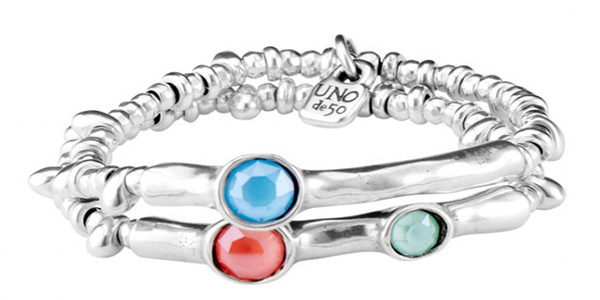 Double elastic bracelet, all silver-plated bathed, composed of several circular pieces and two tubular in the center that include SWAROVSKI® crystals of matte blue, orange and green. All silver-plated bathed. A jewel that you will wear both day at night and which it will be difficult for you to be unnoticed. A design made in Spain by UNOde50 and 100% handmade way.
