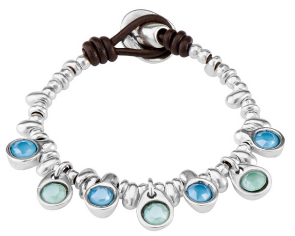 "Original bracelet composed of several silver-plated pieces and closure button. It includes seven SWAROVSKI® crystals of blue and turquoise green color, ""matte effect"", all bathed in silver-plated. A funny jewel that you Will wear daily and at night. A design made in Spain by UNOde50 and 100% handmade way."