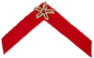 The Valor Strap is a red ruffle ribbon strap with gold starfish and multi-stone ornament.